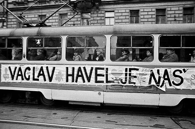 "Prague, December 1989 - A passing tram with a poster in support of Vaclav Havel on his candidacy for president, ""Havel is ours"""